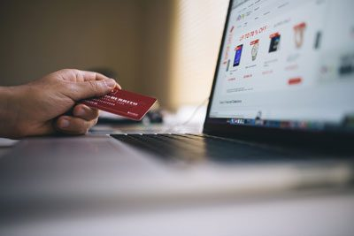 Using a credit card while shopping an eCommerce site on a laptop
