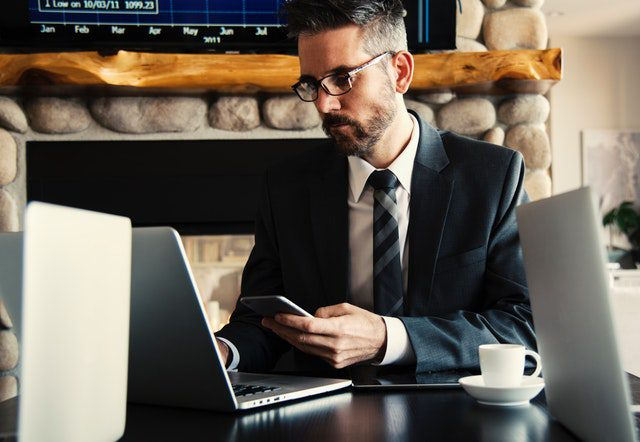 Business owner using CRM software on his laptop